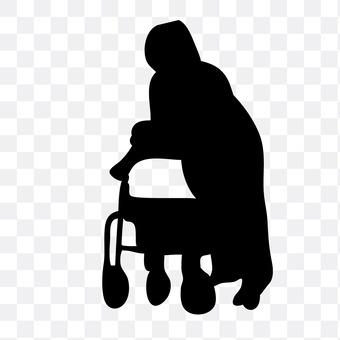 An old man pressing a wheelbarrow