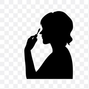 Women painting mascara